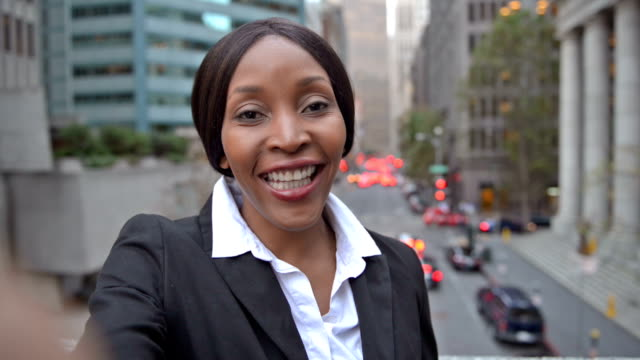 african-american businesswoman with selfie video pov - one woman only videos stock videos & royalty-free footage