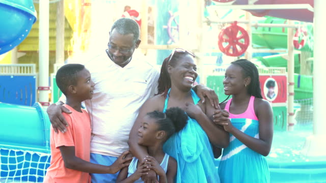 African-American children, grandparents at water park