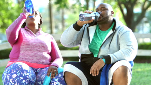 african-american couple drinking water after exercise - overweight stock videos & royalty-free footage