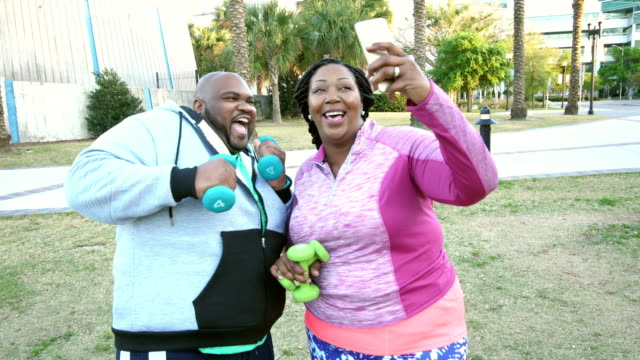 african-american couple exercising, taking selfie - overweight active stock videos & royalty-free footage