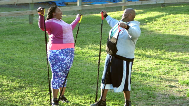 African-American couple exercising with resistance bands