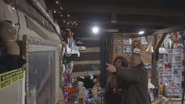african-american couple shop at antique store - selling stock videos & royalty-free footage