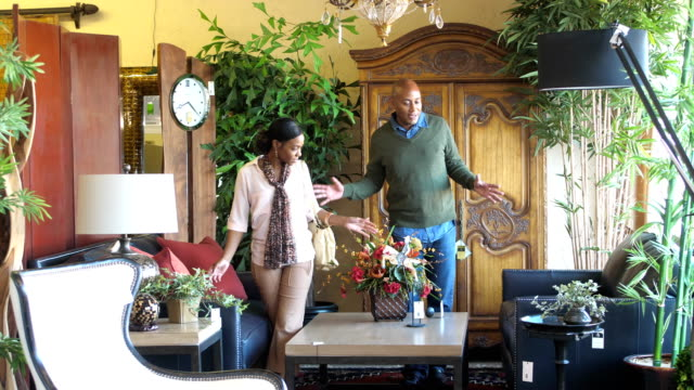 African-American couple shopping in furniture store