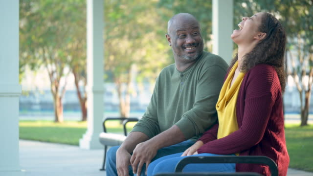 african-american couple sitting on park bench - mature couple stock videos & royalty-free footage