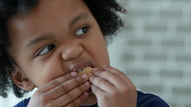 african-american ethnicity little boy drinking eating cookie - hungry stock videos & royalty-free footage
