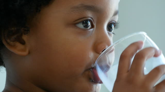 african-american ethnicity little boy drinking milk from mug - milk stock videos & royalty-free footage