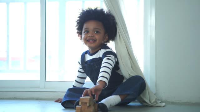 african-american ethnicity little boy playing peekaboo game - peekaboo game stock videos & royalty-free footage