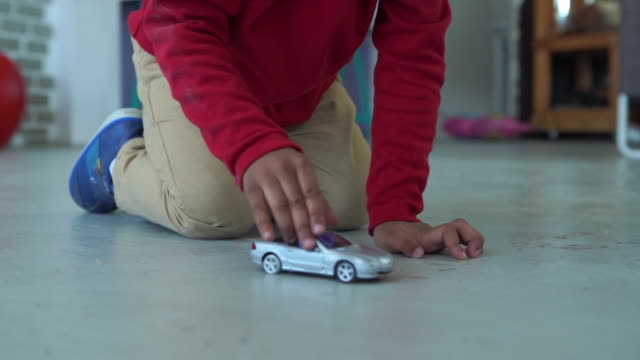 african-american ethnicity little boy playing toy car - toy stock videos & royalty-free footage