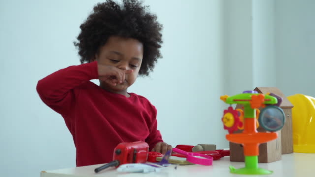 african-american ethnicity little boy playing toy , imagine , aiming about airplane engineer - intelligence stock videos & royalty-free footage