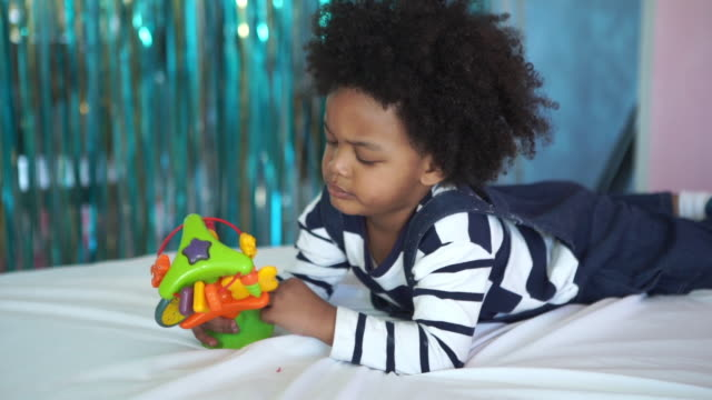 african-american ethnicity little boy playing toy - peekaboo game stock videos & royalty-free footage