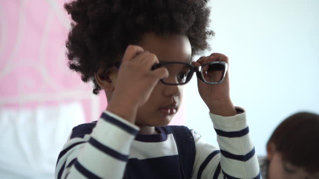 african-american ethnicity little boy tring to wearing eyeglasses and medical stethoscope - eyewear stock videos & royalty-free footage
