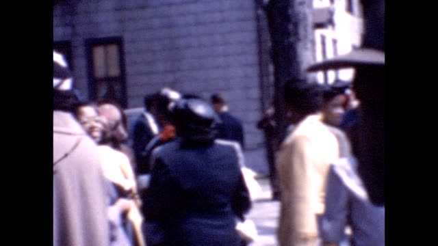 stockvideo's en b-roll-footage met 1955 african-american families outside church - kerk