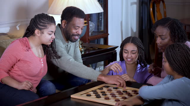 african-american family at home playing checkers - 55 59 years stock videos & royalty-free footage