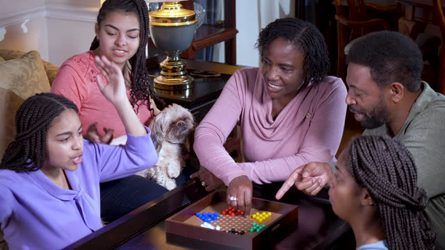 african-american family at home playing chinese checkers - 55 59 years stock videos & royalty-free footage