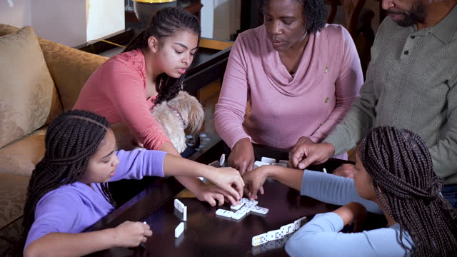 african-american family at home playing dominoes - 55 59 years stock videos & royalty-free footage