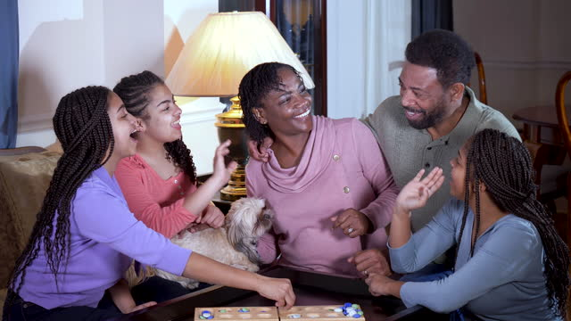 african-american family at home playing mancala - 55 59 years stock videos & royalty-free footage