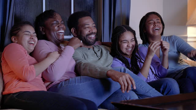 african-american family at home watching tv, laughing - 55 59 years stock videos & royalty-free footage