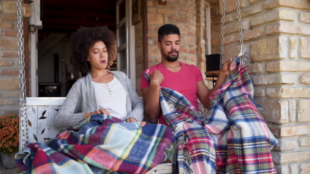 african-american family enjoying morning on porch swing - pyjamas stock videos & royalty-free footage