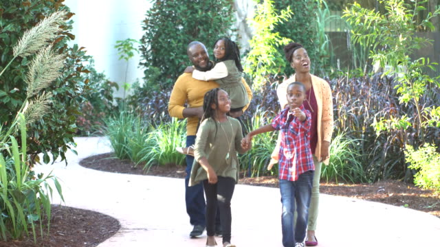 african-american family of five walking through garden - active lifestyle stock videos & royalty-free footage
