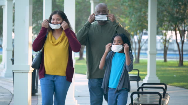 african-american family with masks, covid-19 pandemic - three quarter length stock videos & royalty-free footage