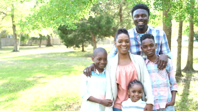 african-american family with three children at park - family with three children stock videos & royalty-free footage