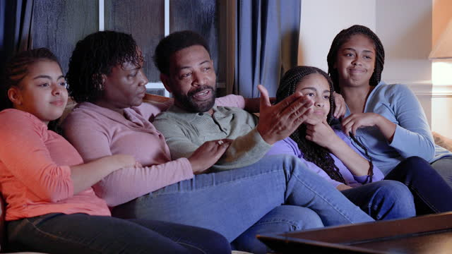 african-american family with three daughters watching tv - 55 59 years stock videos & royalty-free footage