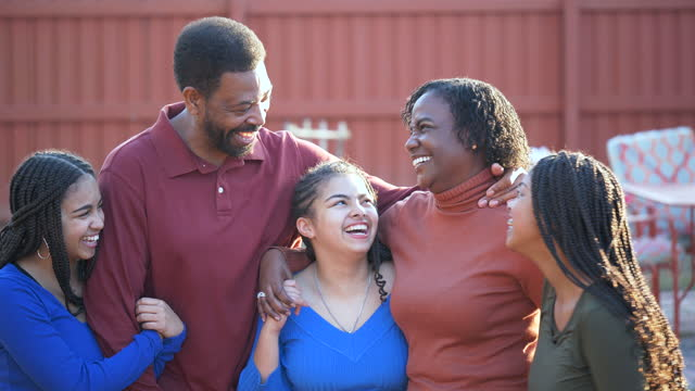 african-american family with three girls talking in backyard - 55 59 years stock videos & royalty-free footage