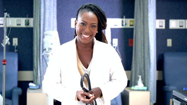 african-american female doctor in medical clinic - waist up stock videos & royalty-free footage