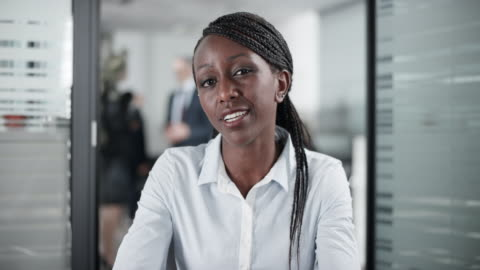 african-american female employee on a video call from the office - businesswear stock videos & royalty-free footage