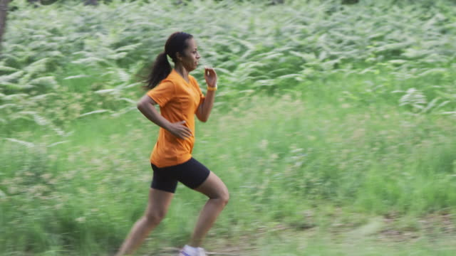SLO MO DS African-American female running in forest
