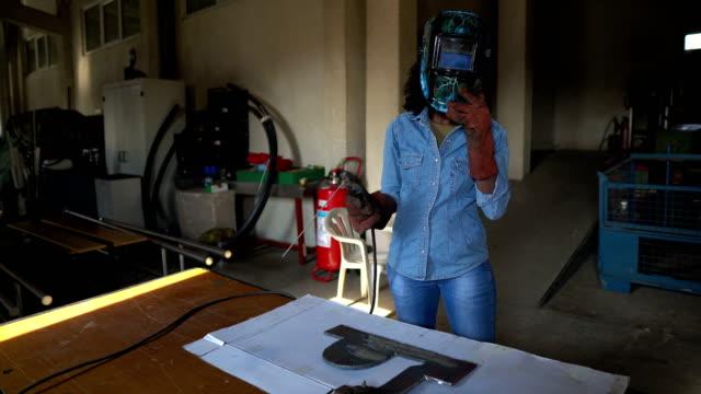 african-american female welder - welding torch stock videos & royalty-free footage