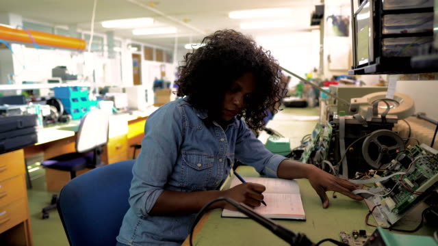 african-american female worker in engineering office - electrical equipment video stock e b–roll