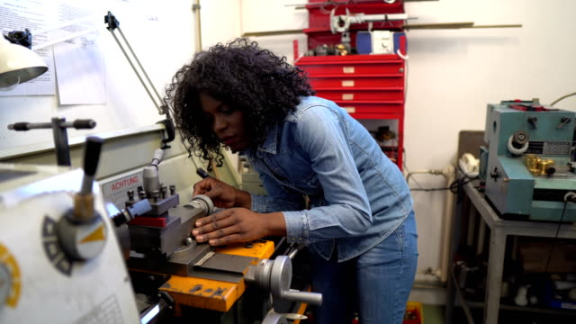 african-american female worker in engineering workshop - manufacturing occupation stock videos & royalty-free footage