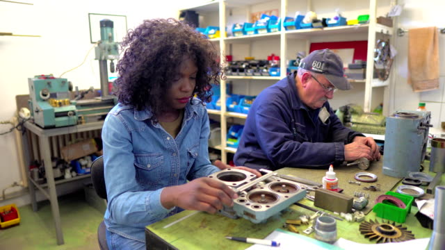african-american female worker in engineering workshop - technician stock videos & royalty-free footage