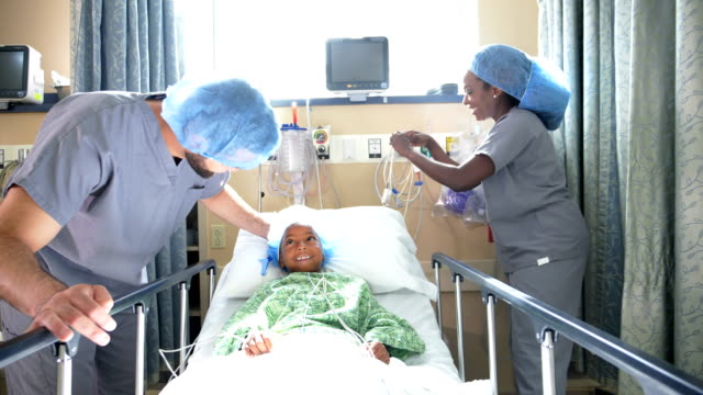 african-american girl in hospital with doctors - operation stock videos & royalty-free footage