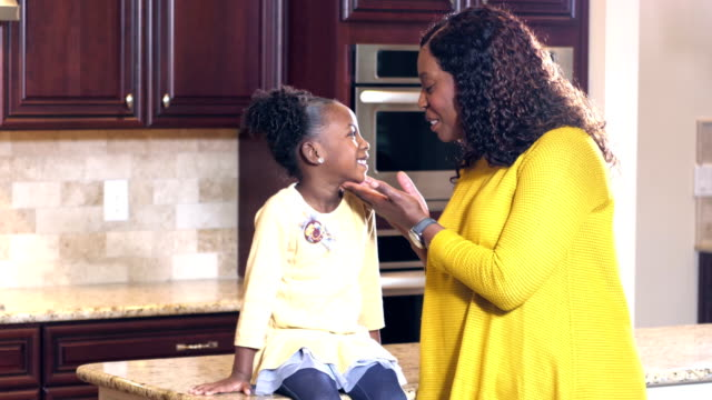 african-american girl in kitchen with grandmother - kitchen worktop stock videos & royalty-free footage