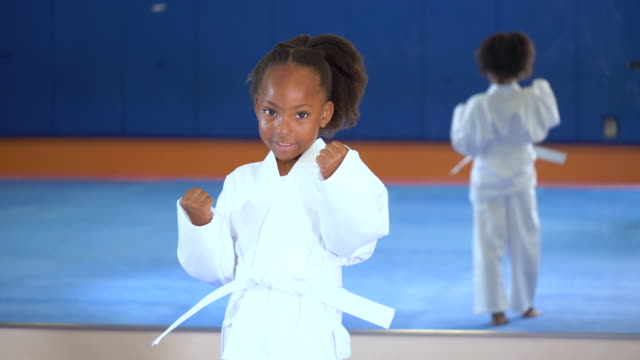 african-american girl learning taekwondo - 6 7 years stock videos & royalty-free footage