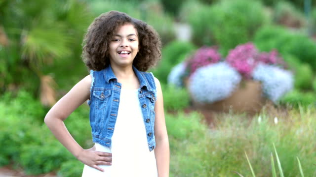 african-american girl smiling in garden - hand on hip stock videos & royalty-free footage