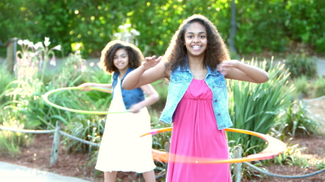 african-american girls playing with hula hoops - sundress stock videos & royalty-free footage