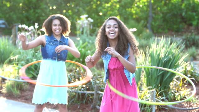 african-american girls playing with hula hoops - plastic hoop stock videos & royalty-free footage