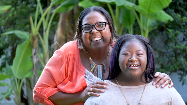 african-american grandmother and teen girl with downs - 55 59 years stock videos & royalty-free footage