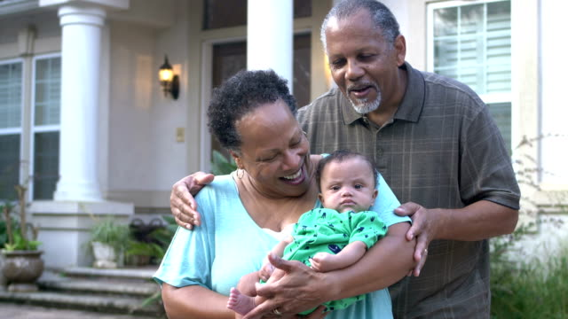 african-american grandparents with baby boy - 60 69 years stock videos & royalty-free footage