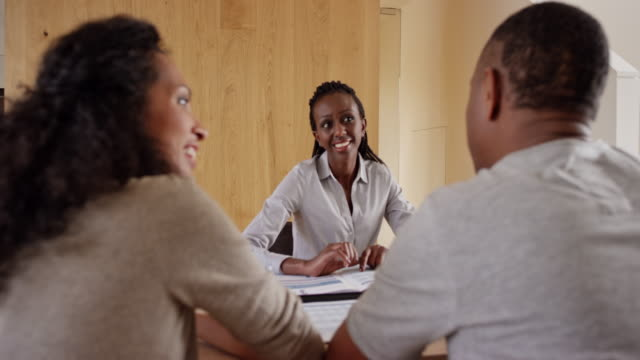 African-American insurance agent advising her clients