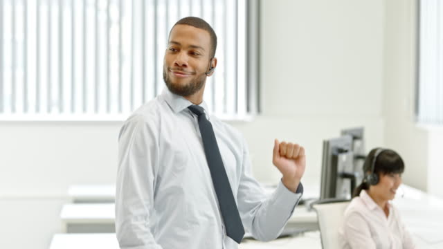 TS African-American male dancing to closing a deal