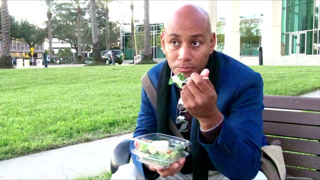 african-american man eating take out food - salad stock videos & royalty-free footage