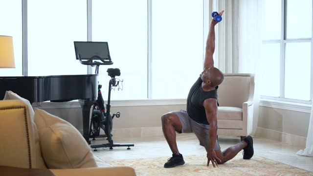 african-american man exercising at home, doing lunges - hand weight stock videos & royalty-free footage