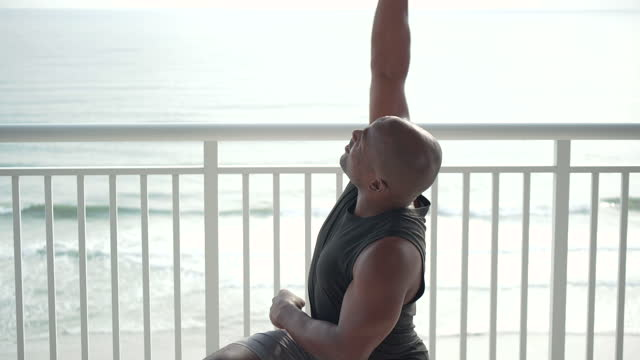african-american man exercising on balcony - hand weight stock videos & royalty-free footage