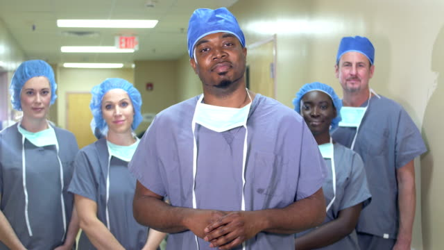 african-american man leading medical team in hospital - scrubs stock videos & royalty-free footage