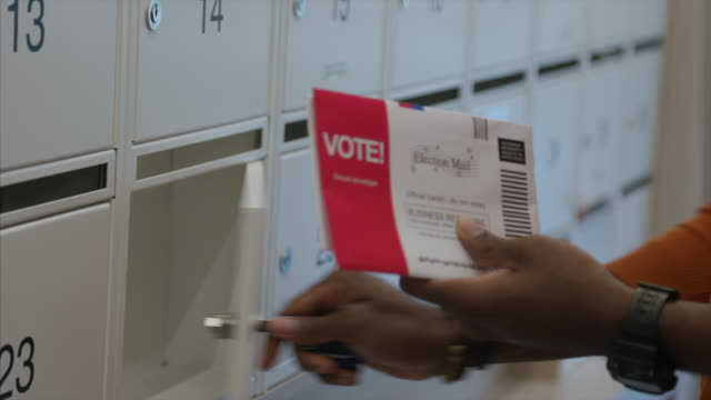 african-american man receiving mail-in voting ballot during usa presidential election - voting ballot stock videos & royalty-free footage
