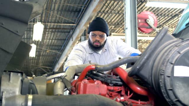 african-american man repairing semi-truck - mechanic stock videos & royalty-free footage